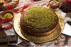 Torta Al cioccolato e pistacchi 免版税库存照片