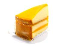 Torta anaranjada con el atasco en el fondo blanco Fotos de archivo libres de regalías