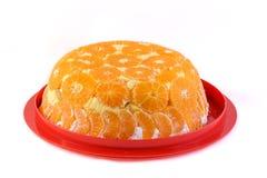Torta anaranjada en una placa Imagen de archivo