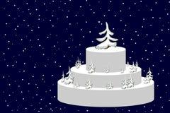 torta celebradora con los árboles del invierno Foto de archivo libre de regalías