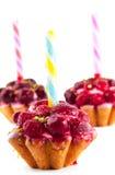 Torta con i lamponi e le ciliege Fotografia Stock