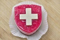 Torta con la bandera de Suisse Foto de archivo libre de regalías