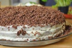 Torta con le rasature del cioccolato Fotografie Stock