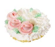 Torta con tre rose decorative sopra bianco Fotografia Stock