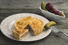 Torta in crosta di carne di maiale britannica tradizionale Fotografie Stock