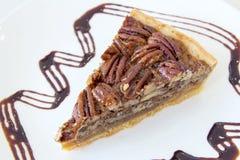 Close up da fatia da torta de noz-pecã Imagens de Stock