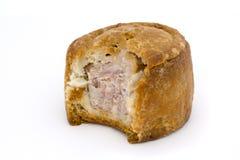 Torta de carne de porco pequena com a mordida tomada Imagem de Stock