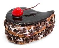 Torta de chocolate con la cereza en tapa fotografía de archivo