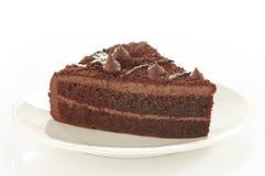 Torta de chocolate en la placa blanca fotos de archivo libres de regalías