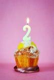 Torta de cumpleaños con la vela ardiente como número dos Foto de archivo libre de regalías