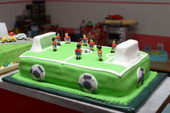 Torta de cumpleaños del bebé del fútbol fotografía de archivo