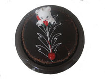 Torta de formación de hielo del chocolate con el oso de la vela Imágenes de archivo libres de regalías
