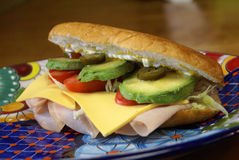 Torta de Jamon Sandwich. Traditional Mexican ham sandwich (torta) served with ham, cheese, lettuce, onion, tomato, avocado, jalapeno on French Baggett bread Royalty Free Stock Photography