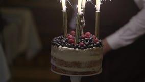 Torta de la celebración en el partido metrajes