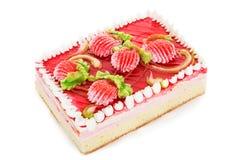 Torta de la galleta adornada con las flores poner crema aisladas en blanco Fotografía de archivo libre de regalías