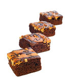 Torta del brownie en el fondo blanco imagenes de archivo
