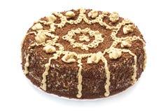 Torta del chocolate y de la amapola aislada en blanco Imagen de archivo libre de regalías