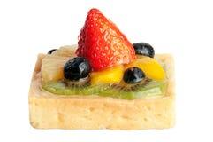 Torta deliciosa de la fresa con el kiwi y el blueber anaranjados de la piña Foto de archivo
