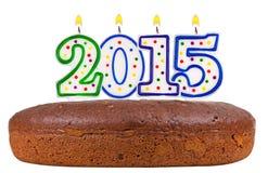 Torta di compleanno con le candele numero 2015 isolata Fotografia Stock Libera da Diritti