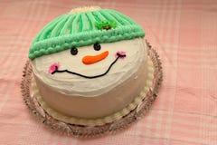 Torta di compleanno del pupazzo di neve Immagine Stock