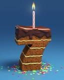 Torta di compleanno a forma di di numero sette Immagine Stock Libera da Diritti