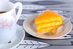 Torta e caffè arancioni Fotografia Stock