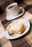 Torta e caffè sulla tabella Fotografia Stock