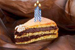 Torta e candele Fotografia Stock