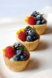 Torta miniatura della frutta Fotografia Stock