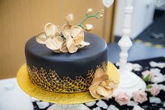 Torta negra del oro Imagen de archivo