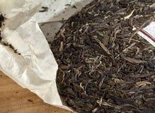 Torta verde del tè del puer Fotografie Stock Libere da Diritti