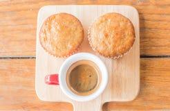 Torta y café express de la taza del plátano Imagenes de archivo