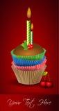 Torta y vela de la taza Fotos de archivo