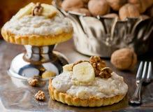 Tortas y nueces de la crema del plátano Imagen de archivo
