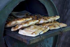 Torte di carne nella porta del forno immagini stock libere da diritti