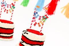 Torte di compleanno rosse per i bambini gemellati Fotografia Stock Libera da Diritti