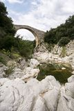 Medieval bridge. Tortella Bridge over llierca river Stock Photography