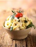 tortellini соуса сыра arugula стоковые изображения