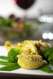 Tortellini. With mangetout and broccoli royalty free stock images