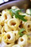 Tortellini And Cream Sauce Stock Photo