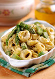 Tortellini with asparagus Stock Images
