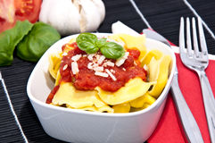 Tortellini with blurred ingredients Royalty Free Stock Photography