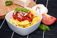 Tortellini in a bowl with ingredients Royalty Free Stock Photos