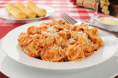Tortellini and breadsticks Royalty Free Stock Images