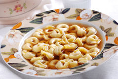 Tortellini in broth Stock Photos