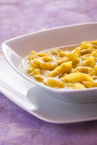 Tortellini in broth in a white plate Stock Photos