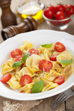 Tortellini with cheese and tomatoes Stock Photos