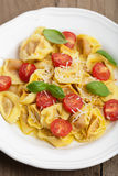 Tortellini with cheese and tomatoes Stock Photography