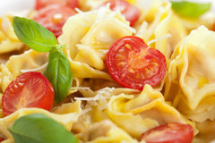 Tortellini with cheese and tomatoes Royalty Free Stock Photo