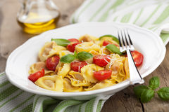Tortellini with cheese and tomatoes Stock Image